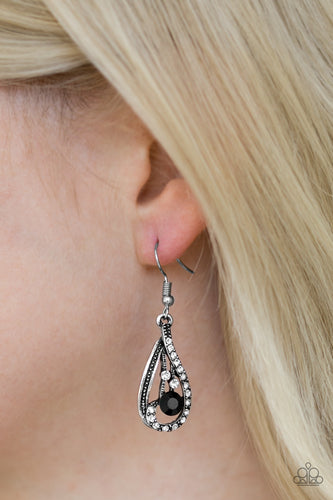 Varying in size, white and black rhinestones are haphazardly sprinkled along a glistening silver teardrop, creating a showy lure. Earring attaches to a standard fishhook fitting.  Sold as one pair of earrings.  Always nickel and lead free.