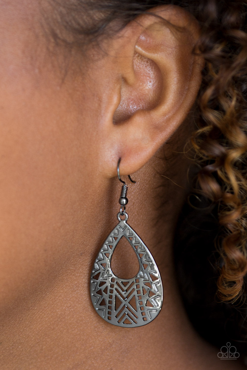 Brushed in a high-sheen finish, edgy geometric patterns climb a shiny gunmetal teardrop for a trendy tribal look. Earring attaches to a standard fishhook fitting.  Sold as one pair of earrings.  Always nickel and lead free.