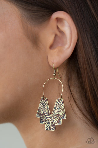 Embossed in tactile tribal inspired patterns, an abstract geometric frame swings from a brass wire fitting for a tribal inspired look. Earrings attaches a standard fishhook fittings.  Sold as one pair of earrings.  Always nickel and lead free.