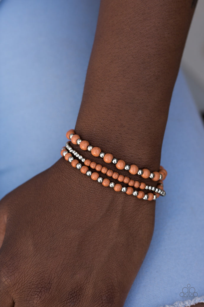 Earthy brown stones and shiny silver beading are threaded along three stretchy elastic bands, creating colorful layers across the wrist.  Sold as one set of three bracelets.  Always nickel and lead free.