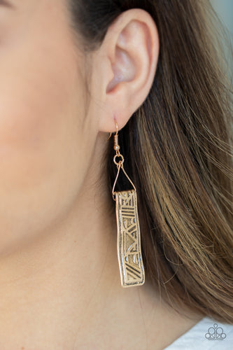 Embossed in glyph-like patterns, a hammered gold frame swings from a dainty wire fitting for a tribal inspired finish. Earring attaches to a standard fishhook fitting.  Sold as one pair of earrings.  Always nickel and lead free.