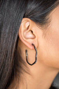 "A glistening gunmetal bar zigzags into an edgy hoop for a fierce industrial look. Earring attaches to a standard post fitting. Hoop measures 1 1/2"" in diameter.  Sold as one pair of hoop earrings.  Always nickel and lead free."