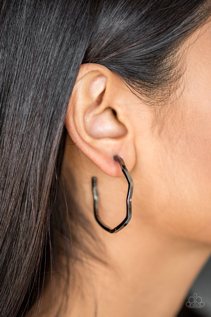 A glistening gunmetal bar zigzags into an edgy hoop for a fierce industrial look. Earring attaches to a standard post fitting. Hoop measures 1 1/2