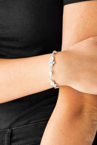Infused with trios of glassy white rhinestones, glittery white marquise-cut rhinestones link around the wrist for a refined look. Features an adjustable clasp closure.  Sold as one individual bracelet Always nickel and lead free.