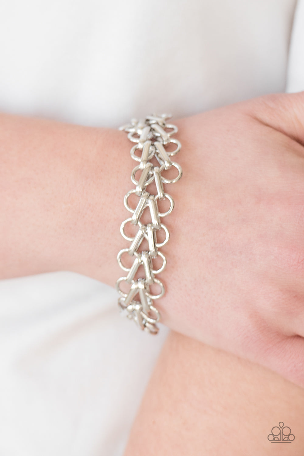 Bold silver frames link across the wrist for a fierce industrial look. Features an adjustable clasp closure.  Sold as one individual bracelet.  Always nickel and lead free.