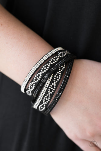 A mishmash of black and white rhinestones and faceted silver beads are sprinkled along strands of black suede for a sassy look. The elongated design allows for a trendy double wrap around the wrist. Features an adjustable snap closure.  Sold as one individual bracelet.   Always nickel and lead free.