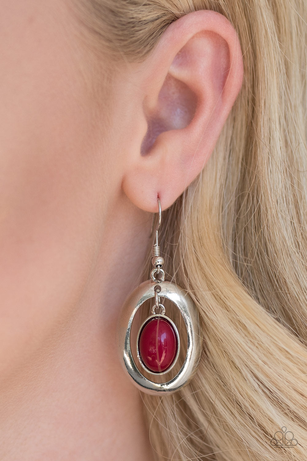 Tinted in the robust shade of wine, a shiny red bead swings from the top of a shimmery silver frame, creating a whimsical lure. Earring attaches to a standard fishhook fitting.  Sold as one pair of earrings.  Always nickel and lead free.
