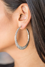 "Load image into Gallery viewer, Delicately hammered in shimmery textures, a glistening silver hoop curls around the ear for a fierce fashion. Earring attaches to a standard post fitting. Hoop measures 2"" in diameter.  Sold as one pair of hoop earrings.  Always nickel and lead free."
