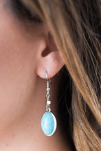 Load image into Gallery viewer, A smooth turquoise stone is pressed into a sleek silver frame, creating an earthy lure. Earring attaches to a standard fishhook fitting.  Sold as one pair of earrings.  Always nickel and lead free.