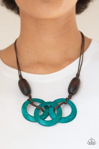 Infused with dramatic brown wooden beads, vivacious blue wooden hoops are knotted in place below the collar for a summery flair. Features an adjustable sliding knot closure.  Sold as one individual necklace. Includes one pair of matching earrings.  Always nickel and lead free.