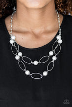Load image into Gallery viewer, Two rows of white pearls and silver oval frames alternate below the collar, creating luminescent layers. Features an adjustable clasp closure.  Sold as one individual necklace. Includes one pair of matching earrings.  Always nickel and lead free.
