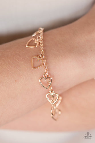 Dainty rose gold hearts dangle from the wrist in a flirty fashion. Features an adjustable clasp closure  Sold as one individual bracelet.  Always nickel and lead free.
