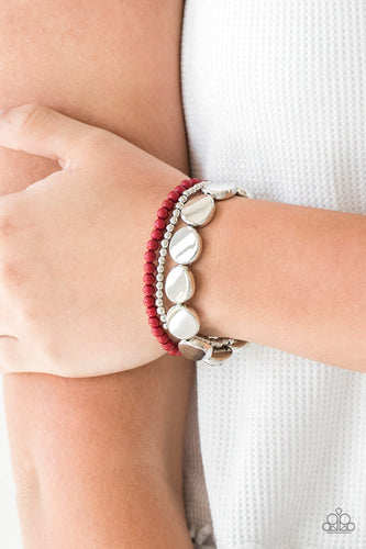 Mismatched silver and red beads and round silver accents are threaded along stretchy bands, creating colorful layers around the wrist.  Sold as one set of three bracelets.   Always nickel and lead free.
