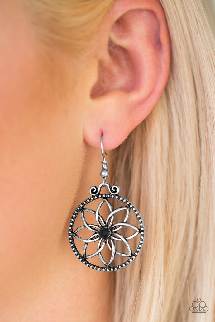 Brushed in an antiqued shimmer, glistening silver bars bend into airy petals. A glittery black rhinestone dots the floral center for a feminine finish. Earring attaches to a standard fishhook fitting.  Sold as one pair of earrings.  Always nickel and lead free.