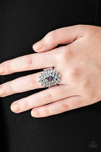 Dotted in dainty white rhinestones, silver petals radiate from a regal purple marquise shaped rhinestone center for an edgy look. Features a stretchy band for a flexible fit.  Sold as one individual ring.  Always nickel and lead free!