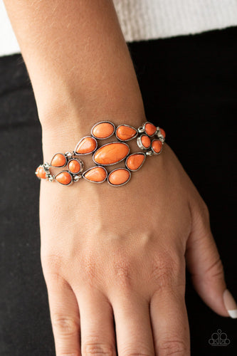 Featuring studded silver frames, a collection of orange teardrop, oval, and round stone beads connect across the wrist, creating a bold floral frame atop the wrist. Features an adjustable clasp closure.  Sold as one individual bracelet.  Always nickel and lead free.
