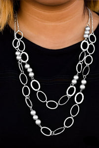 Pearly silver beads and shiny silver ovals featuring smooth, serrated, and hammered finishes link below the collar in two refined layers. Features an adjustable clasp closure.  Sold as one individual necklace. Includes one pair of matching earrings.  Always nickel and lead free.