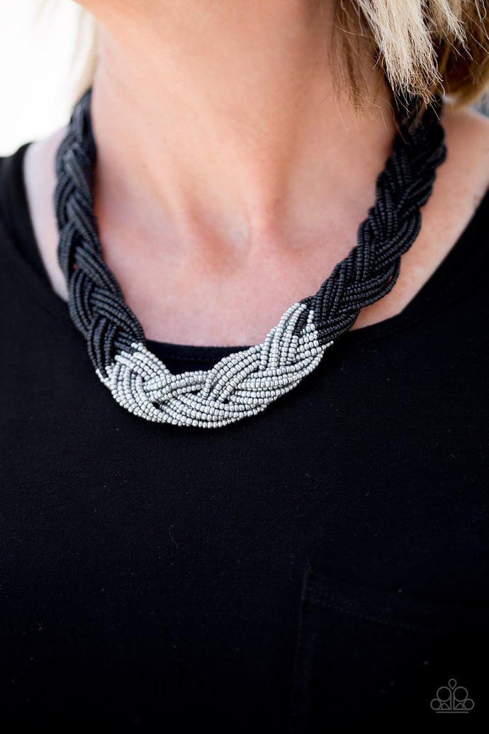 Strands of black seed beads create an indigenous braid below the collar. The black seed beads gradually morph into metallic silver beads at the center for a chic contrasting look. Features an adjustable clasp closure.  Sold as one individual necklace. Includes one pair of matching earrings.  Always nickel and lead free