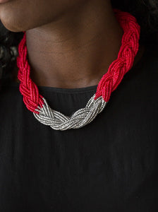 Strands of red seed beads create an indigenous braid below the collar. The red seed beads gradually morph into metallic silver beads at the center for a chic contrasting look. Features an adjustable clasp closure.  Sold as one individual necklace. Includes one pair of matching earrings.  Always nickel and lead free.
