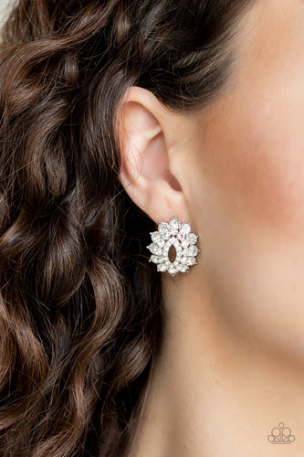 Varying in size, three stacks of glittery white rhinestones fan out from an airy center, coalescing into a stellar frame. Earring attaches to a standard post fitting.  Sold as one pair of post earrings.  Always nickel and lead free.