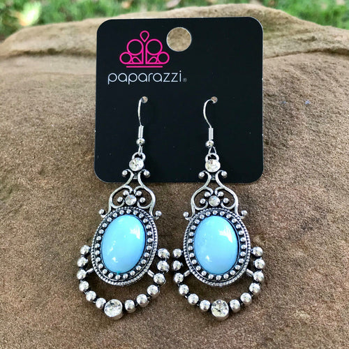 A refreshing light blue bead is pressed into an ornate silver frame swirling with frilly silver filigree and shiny silver studs. Glassy white rhinestones sporadically dot the frame for a sparkling finish. Earring attaches to a standard fishhook fitting.  Sold as one pair of earrings.  Always nickel and lead free
