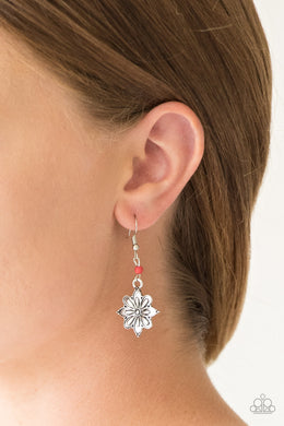 Brushed in a high-sheen finish, a glistening silver flower frame swings from the bottom of a dainty red stone for a seasonal look. Earring attaches to a standard fishhook fitting.  Sold as one pair of earrings.  Always nickel and lead free.