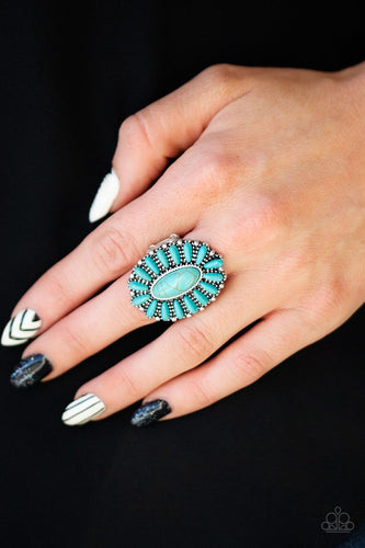 Vivacious turquoise stones are pressed into a studded silver frame, coalescing into a whimsical floral centerpiece atop the finger. Features a stretchy band for a flexible fit.  Sold as one individual ring.  Always nickel and lead free.