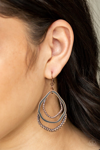 Featuring mismatched textures, hammered copper hoops join into an asymmetrical lure for a seasonal look. Earring attaches to a standard fishhook fitting.  Sold as one pair of earrings. Always nickel and lead free.