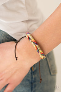Brown and multicolored twine weave around the wrist, creating a colorful braid. Features an adjustable sliding knot closure.  Sold as one individual bracelet.  Always nickel and lead free.
