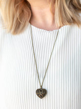Load image into Gallery viewer, Encrusted in glittery black rhinestones, a vintage inspired heart pendant swings from the bottom of a shimmery brass chain for a romantic fashion. Features an adjustable clasp closure.  Sold as one individual necklace. Includes one pair of matching earrings.  Always nickel and lead free.