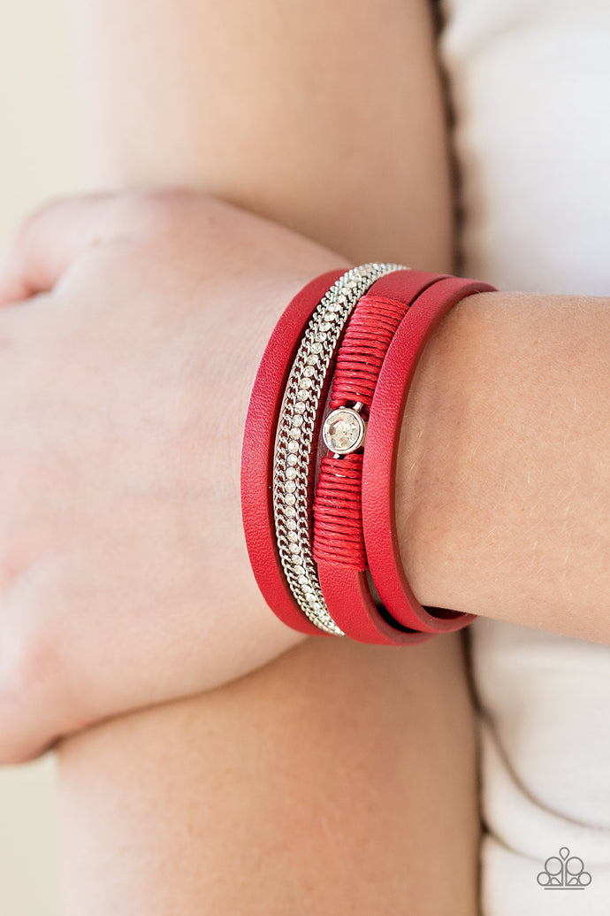 Red leather strands layer across the wrist. Infused with silver chain and white rhinestone accents, red cording knots around a leather strand, securing a solitaire white rhinestone in place for a whimsical finish. Features an adjustable clasp closure.  Sold as one individual bracelet.  Always nickel and lead free.