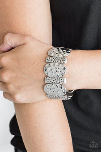 Delicately hammered in antiqued detail, round and rectangular shaped frames are threaded along stretchy bands, creating a bold tribal look around the wrist.  Sold as one individual bracelet.  Always nickel and lead free.