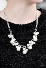Load image into Gallery viewer, Clusters of large and small white pearls cascade from the bottom of a bold silver chain, creating a refined fringe below the collar. Features an adjustable clasp closure.  Sold as one individual necklace. Includes one pair of matching earrings.  Always nickel and lead free.