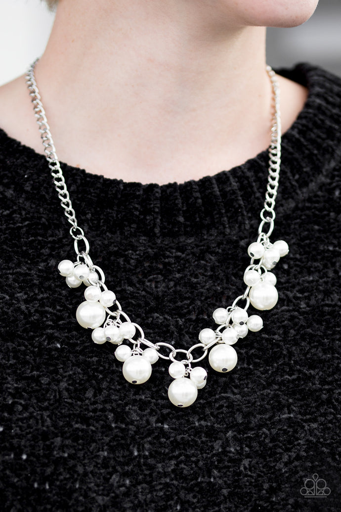 Clusters of large and small white pearls cascade from the bottom of a bold silver chain, creating a refined fringe below the collar. Features an adjustable clasp closure.  Sold as one individual necklace. Includes one pair of matching earrings.  Always nickel and lead free.