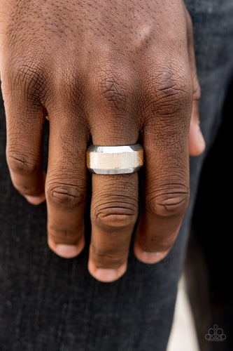The center of a beveled silver band has been delicately hammered in shimmery gold detail for a metro inspired look. Features a stretchy band for a flexible fit.  Sold as one individual ring.  Always nickel and lead free.