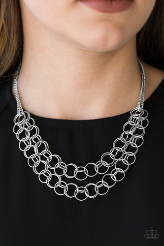 Necklace and Earrings:  Varying in size, rows of shiny silver rings interlock into two layered rows below the collar for an edgy industrial look. Features an adjustable clasp closure.  Bracelet:  Varying in size, rows of shiny silver rings interlock across the wrist for a bold industrial look. Features an adjustable clasp closure.