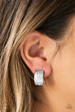 Load image into Gallery viewer, Rippling with tactile textures, a shimmery silver ribbon curls into an edgy frame for a causal look. Earring attaches to a standard clip-on fitting.  Sold as one pair of clip-on earrings.   Always nickel and lead free.