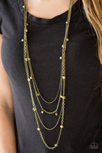 Load image into Gallery viewer, Varying in shape and shimmer, four glistening brass chains drape across the chest. Glassy and pearly brass beading alternate along the shimmery layers for a refined finish. Features an adjustable clasp closure.  Sold as one individual necklace. Includes one pair of matching earrings.  Always nickel and lead free.