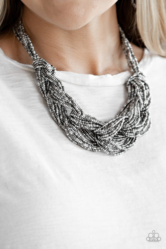 Brushed in a flashy finish, countless strands of silver and gunmetal seed beads weave into a bulky square braid below the collar for a glamorous look. Features an adjustable clasp closure.  Sold as one individual necklace. Includes one pair of matching earrings.  Always nickel and lead free.