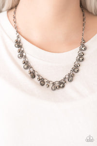 Faceted gunmetal beads and glittery hematite rhinestone encrusted frames swing from the bottom of a bold gunmetal chain, creating a sassy fringe below the collar. Features an adjustable clasp closure.  Sold as one individual necklace. Includes one pair of matching earrings.  Always nickel and lead free.