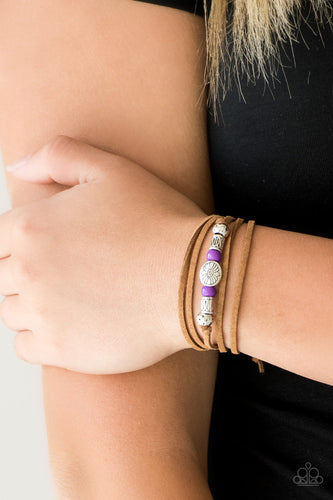 An array of purple and silver beads are knotted in place along elongated suede cording for a wanderlust fashion. To secure bracelet, tie ends in place around the wrist at desired length.  Sold as one individual bracelet.  Always nickel and lead free.