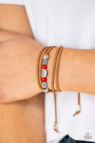 An array of red and silver beads are knotted in place along elongated suede cording for a wanderlust fashion. To secure bracelet, tie ends in place around the wrist at desired length.  Sold as one individual bracelet.  Always nickel and lead free.