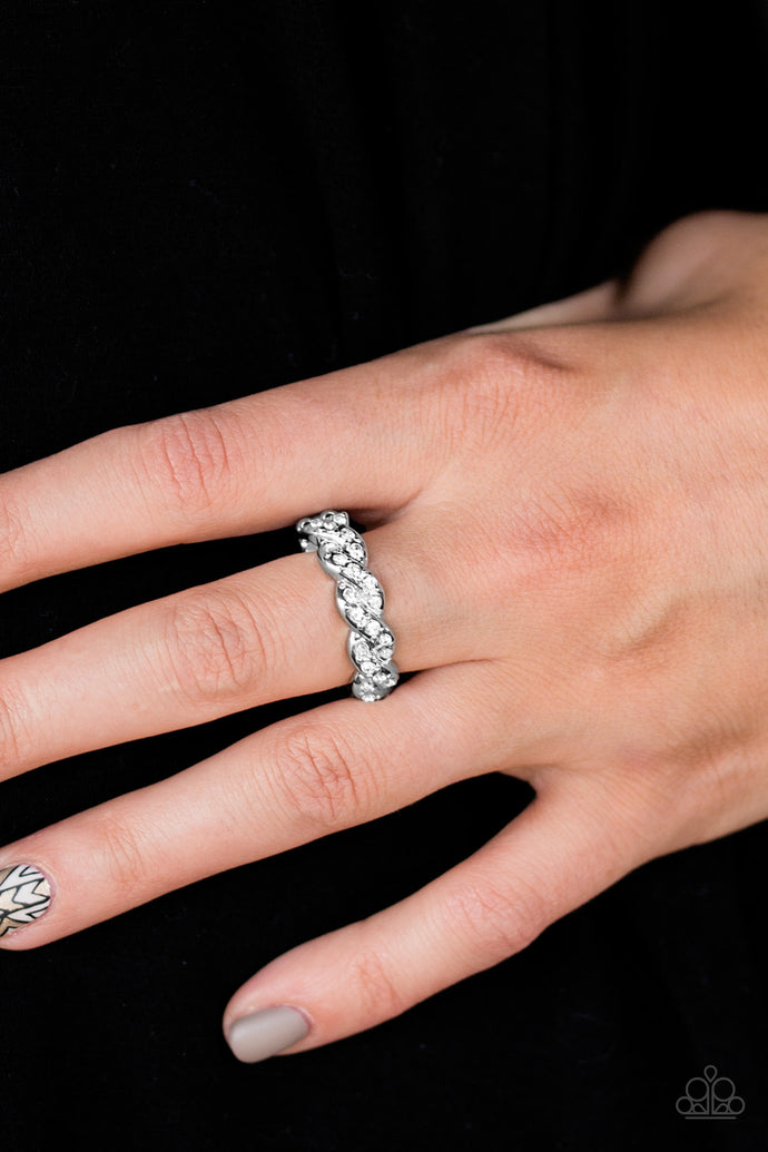 Encrusted in dainty white rhinestones, glistening silver bars braid across the finger for a refined look. Features a dainty stretchy band for a flexible fit.  Sold as one individual ring.  Always nickel and lead free.