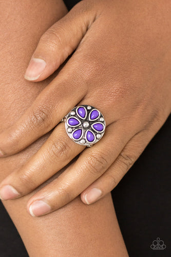 Vivacious purple beads are pressed into a studded silver frame, creating a colorful floral centerpiece atop the finger. Features a stretchy band for a flexible fit.  Sold as one individual ring.  Always nickel and lead free.