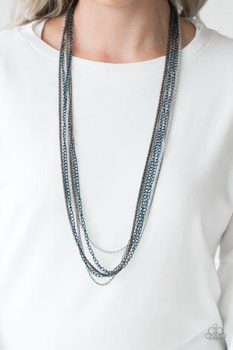 Brushed in a metallic finish, blue chains collide with mismatched gunmetal and silver chains across the chest. Shimmery silver and gunmetal popcorn chains join the colorful layers, adding shimmery metallic texture to the spunky mixed palette. Features an adjustable clasp closure.  Sold as one individual necklace. Includes one pair of matching earrings.  Always nickel and lead free.