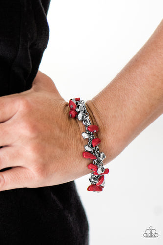 Infused with layers of mismatched silver chains, fiery red rock beading and faceted silver beading trickle from a shimmery silver chain, creating an earthy fringe around the wrist. Features an adjustable clasp closure.  Sold as one individual bracelet.   Always nickel and lead free.