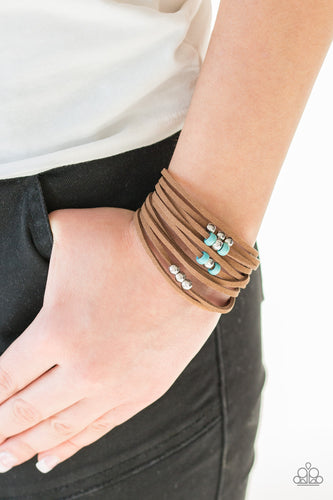Dainty turquoise stone beads and classic silver beads are threaded along strands of brown suede, creating colorful layers across the wrist. Features an adjustable clasp closure.  Sold as one individual bracelet.  Always nickel and lead free.