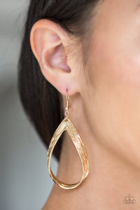 Scratched in shimmery textures, a glistening gold ribbon loops into a refined lure. Earring attaches to a standard fishhook fitting.  Sold as one pair of earrings.  Always nickel and lead free.