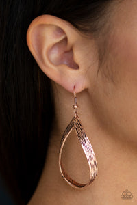 Scratched in shimmery textures, a glistening copper ribbon loops into a refined lure.  Earring attaches to a standard fishhook fitting.  Always nickel and lead free.