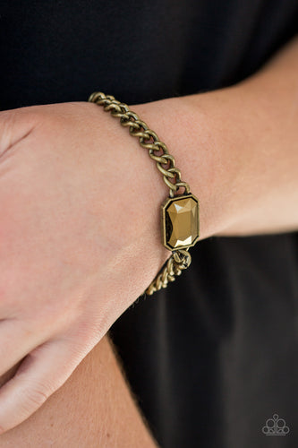 Featuring an edgy emerald-style cut, a glittery aurum gem attaches to a bold brass chain, creating a dramatic centerpiece atop the wrist. Features an adjustable clasp closure.  Sold as one individual bracelet.  Always nickel and lead free.